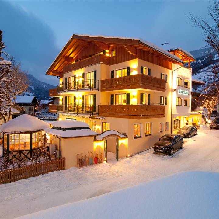 Snow-covered hotel in the winter ski resort at night